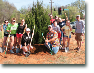 Bill Long with young volunteers planting trees